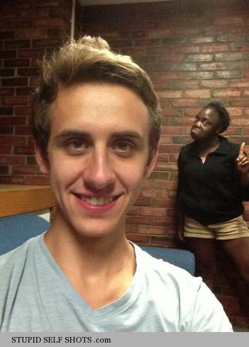 Disapproving black girl photobomb, self shot