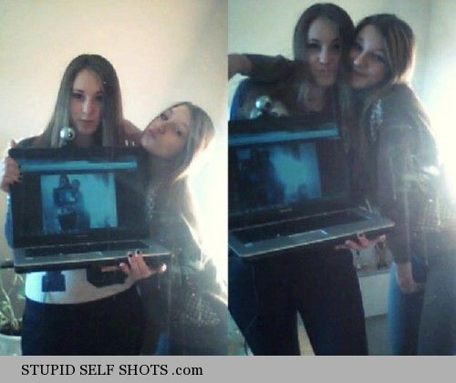 Two girls with a huge laptop, group self shot