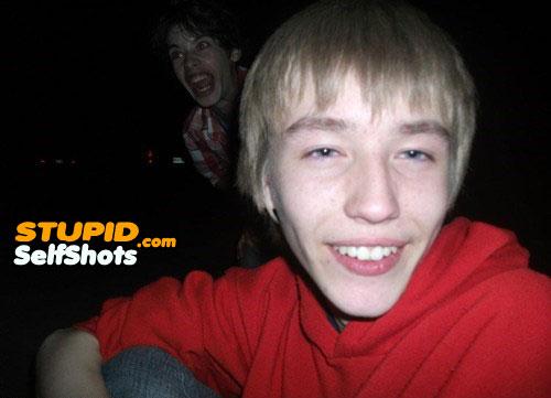 Creepy brother photobombs the selfie