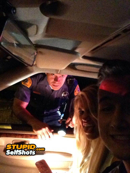 Getting pulled over, irritated cop photobombs a self shot