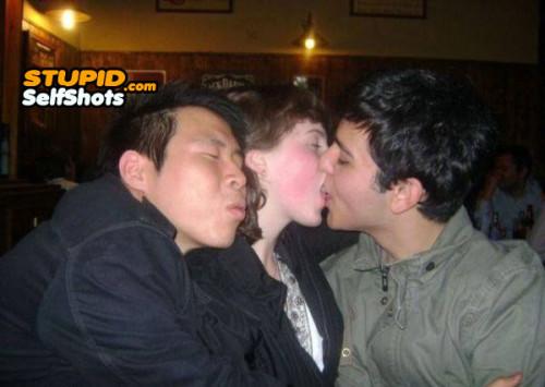 3's a crowd, kissing selfie
