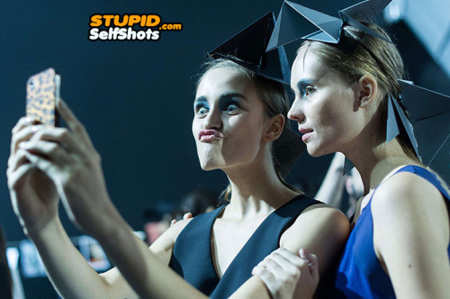 Graduation made her go super duck face for her selfie