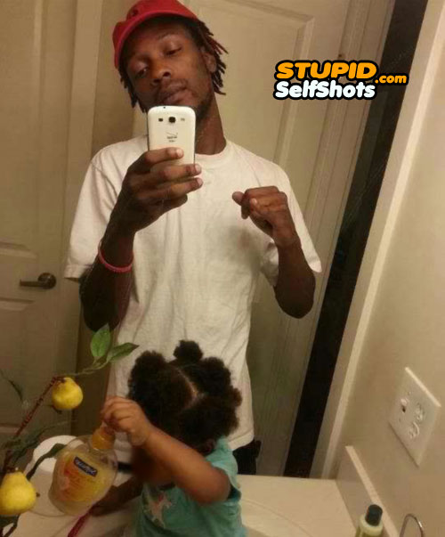 Kid playing witht he hand soap, bathroom selfie