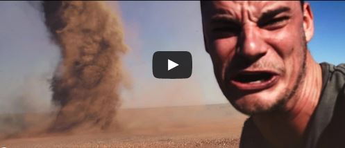 The definition of a Stupid Selfie, Aussie runs up to a Tornado to take a Selfie